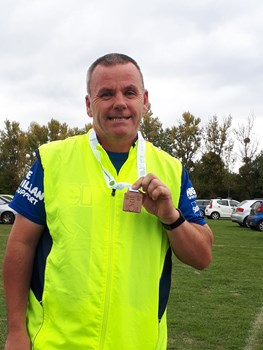 andy distin proudly shows off his medal at taunton 10k.jpg