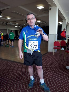 andy distin shows of his weymouth half marathon medal..jpeg