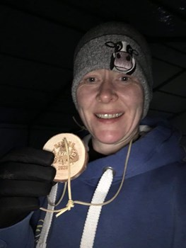suzi mills with her hard earned medal after the beyond the far side.jpg