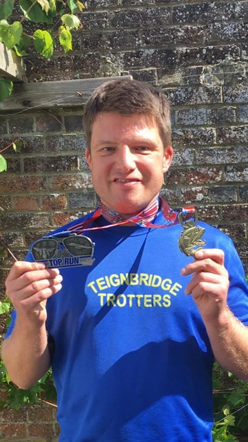 richard with his medals.jpg