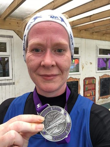 suzie mills shows off her hard earned medal at lopwell loop.jpg