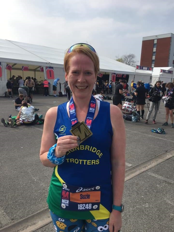 suzie mills also looking pleased with her manchester marathon medal.jpg